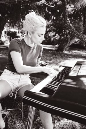 "Lady Gaga from the Joanne booklet, jamming out on electric piano as heard on ""Come To Mama"""